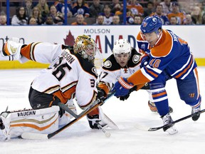 Anaheim Ducks goalie John Gibson (36) makes the save on Edmonton Oilers' Nail Yakupov (10) as Hampus Lindholm (47) defends during first period NHL action in Edmonton, Alta., on Monday March 28, 2016.