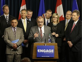 Ric McIver (middle/at podium), Interim Party Leader, and the Alberta Progressive Conservative Party Caucus, launched a new public engagement initiative at the Alberta Legislature on Monday.