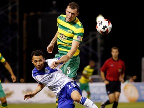Tampa Bay Rowdies defender Neill Collins, right, heads a ball in front of FC Edmonton midfielder Cristian Raudales in a North America Soccer League match in Tampa, Florida on Saturday. Tampa Bay won 1-0.