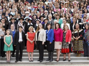 Women from all walks of life, including Premier Rachel Notley, pose Tuesday for a photo on the steps of the Alberta legislature to commemorate the 100-year anniversay of the equal suffrage law that gave most women the right to vote.