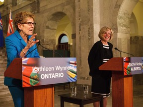 Ontario Premier Kathleen Wynne, left, and Alberta Premier Rachel Notley, right, hold a media availability to discuss an energy innovation partnership between Alberta and Ontario at the Alberta Legislature Building in Edmonton on Thursday, May 26, 2016.