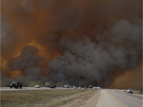Residents of Fort McMurray flee southbound on Highway 63 after wildfires forced the evacuation of the city in May 2016.