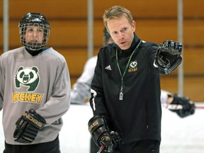 EDMONTON, ALBERTA: JANUARY 28, 2015 - University of Alberta Pandas' head coach Howie Draper (right) gives instruction during team practice at Clare Drake Arena on January 28, 2014. Story by Richard Cantangay-Liew. (PHOTO BY LARRY WONG/EDMONTON JOURNAL)