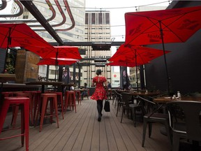 The rooftop patio at Edmonton's Craft Beer Market is a cheery red oasis above Rice Howard Way.