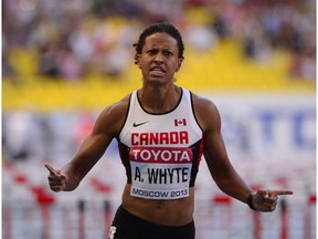Canada's Angela Whyte competes during the women's 100 metres hurdles semi-final at the 2013 IAAF World Championships at the Luzhniki stadium in Moscow on August 17, 2013.