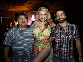 """Burlesque performer Arabella Allure, centre, poses with Guenther Nigogosian, left, and Tommy """"Helicopter,"""" right, during Commedia Burlesco."""