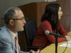 Dr. Joanna Oda (right), medical officer of health, Alberta Health Services and Trevor Theman, the College of Physicians and Surgeons of Alberta's registrar, speak about a joint investigation that found inadequate reprocessing and sterilization of medical devices in 2015 at North Town Medical Centre during a July 18, 2016, news conference.