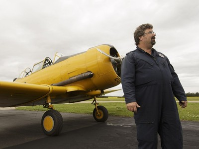 Yellow Thunder pilot David Watson speaks to Edmonton Journal reporter Juris Graney in front of his Harvard airplane from Villeneuve Airport ahead of the Edmonton Air Show in Sturgeon County, on Thursday, July 21, 2016.