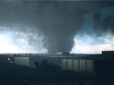 A massive tornado passes from south to north near 34 St., and 94 Ave., in Edmonton on Friday July 31, 1987.