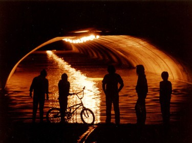 """Edmonton's infamous """"Rat Hole"""" at 109 St. and 104 Ave., is seen flooded after dark. A massive tornado hit Edmonton on Friday July 31, 1987."""