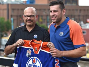 Newly acquired forward, Oiler Milan Lucic and GM Peter Chiarelli before talking to the media in Edmonton, Friday, July 1, 2016. Ed Kaiser/Postmedia