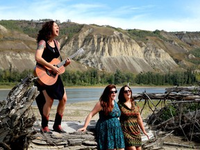 Jody Peck (left), also known as Miss Quincy, performs on the banks of the Peace River with the band Twin Peaks. The performance is part of My Peace River.