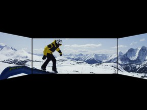 An example of the new Cineplex experience featuring Barco Escape, with two side screens creating a panoramic view.