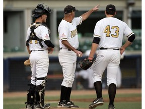 The Edmonton Prospects' Paul Richy (43) is pulled by head coach Ray Brown in the 6th inning against the Medicine Hat Mavericks during Game 4 of  the WMBL playoff series at the former Telus Field, in Edmonton on Monday Aug. 8, 2016. Catcher Logan Wedgewood is pictured left. The Prospects lost the opening game of the WMBL final 3-0 to Swift Current on Thursday.