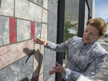 Today marks a construction milestone of the new Royal Alberta Museum. Ernestine Tahedl, is the mosaic panel artist who created the nine panels that previously adorned the Canada Post building on the same site. They have been refurbished and repurposed outside of the new RAM.  Photo by Shaughn Butts / Postmedia  Stuart Thomson story