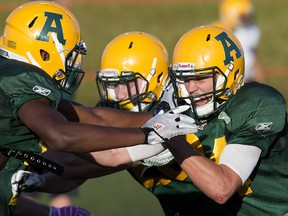 Shaydon Phillip (11) and Ryan Migadel (24) take part in an Alberta Golden Bears football camp practice at Foote Field, in Edmonton on Monday Aug. 15, 2016. Photo by David Bloom Photos off Alberta Golden Bears football camp for Jason Hills story slated to run in Wednesday, Aug. 17 editions.