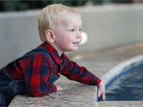 Isaac Tymchuk, 2, plays near a fountain at the Mazankowski Alberta Heart Institute in Edmonton, Alta., on Monday, Sept. 19, 2016. The young toddler from Calgary became the first neonatal cardiac hybrid surgery patient in Western Canada almost two years ago.