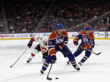 The Edmonton Oilers' Jordan Eberle (14) looks for a shot against the Calgary Flames during first period pre-season NHL action at Rogers Place, in Edmonton on Monday Sept. 26, 2016.