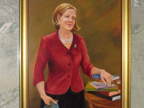 Former Alberta premier Alison Redford's official portrait was added to the legislature's paintings of past premiers on the third floor of the building.