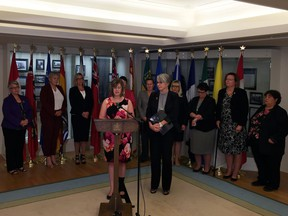 Stephanie McLean, Alberta minister of status of women, and Patty Hajdu, federal minister of status of women, speak to reporters after the annual meeting for status of women ministers from across Canada on Sept. 15, 2016.