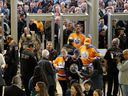 Hockey fans go through security screening at Rogers Place.