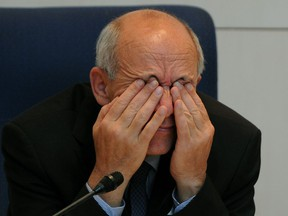 City of Edmonton Mayor Stephen Mandel rubs his eyes during a discussion at city hall about the proposed downtown arena on Wednesday October 17, 2012.