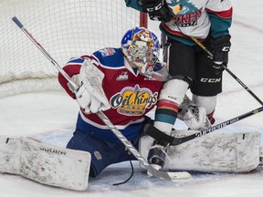 Liam Hughes of the Edmonton Oil Kings, makes a save against Kelowna Rockets at Rogers Place in Edmonton on October 7, 2016. Hughes earned his first victory of the season Sunday afternoon in a 3-2 overtime win, on the road, against the Saskatoon Blades.