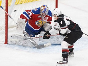 Edmonton Oil Kings goaltender Liam Hughes shuts the door on Vancouver Giants forward Ty Ronning during a WHL game at Rogers Place in Edmonton, Alta., on Tuesday, Oct. 11, 2016.