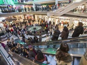 Retail experts predict Canadian Christmas shoppers like these people in Toronto's Eaton Centre will open their wallets wider this holiday season, even in economically hard-hit Alberta.