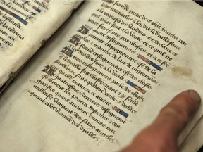The book Invectives Against the Sect of Witches, with text illuminated with gold leaf, is one of only four copies in the world. Photographed at the University of Alberta in October 2012.