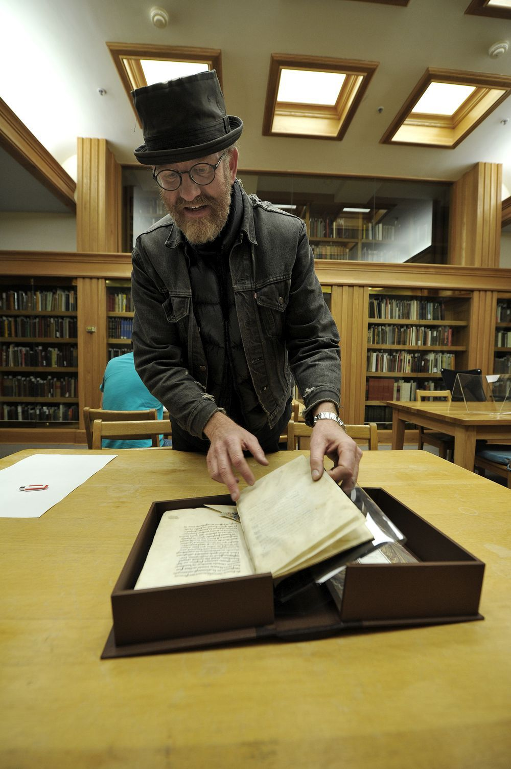 U of A history professor Andrew Gow looks over an extremely rare copy of the book Arguments Against the Sect of Witches, written by Dominican monk Johanes Tinctor, which is held at the U of A's Rutherford Library. Photographed October 2012.