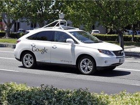 This May 13, 2014 file photo shows a Google self-driving Lexus at a Google event outside the Computer History Museum in Mountain View, Calif.