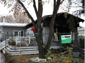 Fire ripped through a southeast Edmonton mobile home at 194 Lee Ridge Rd. on Thursday, Oct. 13, 2016. Homeowners Sherry Robinson and Lawrence Renz said while firefighters rescued one of their dogs, their pet miniature Pinscher and six cats died in the blaze.