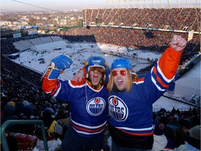 Eric Chaungeu, left and Ryan Steinke, right show how crazy fan are at the Commonwealth Stadium at the start of the Heritage Classic hockey game on Nov. 22, 2003.