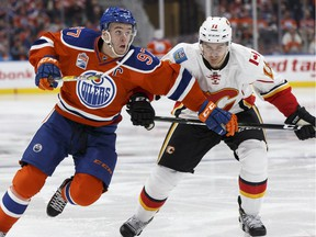 Edmonton's Connor McDavid (97) and Calgary's Mikael Backlund (11) battle during the third period of a NHL game between the Edmonton Oilers and the Calgary Flames at Rogers Place in Edmonton, Alberta on Wednesday, October 12, 2016. Ian Kucerak / Postmedia Photos off Oilers game for multiple writers copy in Oct. 13 editions.