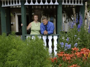 Jack Oosterveld, with his wife Bev in the garden of their Sherwood Park home in 2007, has been banned for life from the mutual fund industry following a decision by  the Mutual Fund Dealers Association of Canada hearing panel this week.