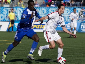 FC Edmonton's Pape Diakite, left, battles the Indy Eleven's Justin Braun during NASL action at Clarke Stadium, in Edmonton on Sunday Oct. 2, 2016. FC Edmonton travel to play the Indy Eleven in an NASL semifinal on Saturday, Nov. 5.