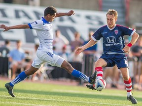 FC Edmonton midfielder Shamit Shome, right, challenges Indy Eleven midfielder Brad Ring for the ball in NASL play on Sunday, July 23, 2016 in Indianapolis, Indiana. The Indy Eleven won 1-0. The two teams play each other in the NASL semifinal on Saturday.