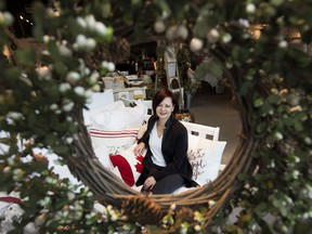 Wabi Sabi Home & Design Studio owner/designer Gwen Saunter-Davis is framed by a Christmas wreath.