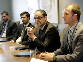 Alberta's Finance Minister Joe Ceci (second from right) met with top economic experts from Canada's financial industry on Dec. 7, 2016, to discuss economic forecasts leading up to Budget 2017.