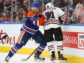 Oscar Klefbom #77 of the Edmonton Oilers defends against Andrew Desjardins #11 of the Chicago Blackhawks on November 21, 2016 at Rogers Place in Edmonton, Alberta, Canada.
