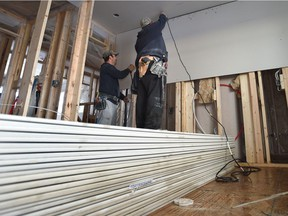 DCL Drywall Inc. contractors installing drywall in a new duplex for story on wrap up of hearing into drywall tariff for Western Canada, in north Edmonton, Wednesday, December 7, 2016.