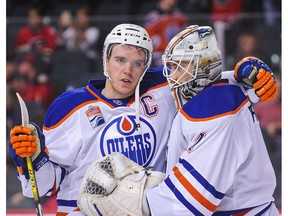 Edmonton Oilers Connor McDavid celebrates goalie Laurent Brossoit's first NHL victory after defeating the Calgary Flames 7-3 at the Scotiabank Saddledome on Jan. 21, 2017. (Getty Images)