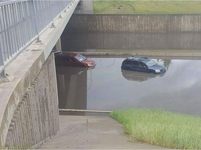Vehicles stranded by a flood on the Whitemud on Wednesday, July 27, 2016.  The city estimates it will cost $2.4 billion to address Edmonton's flood mitigation issues.