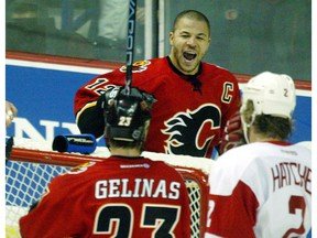 WEDNESDAY, APRIL 28, 2004 PAGE D1 DD Calgary-04/27/04-Jarome Iginla celebrate the Flames 2nd goal in the second period. Photo by Ted Rhodes/Calgary Herald (For Sports story by Scott Cruickshank) ************************************** Filter: No USM: No File Size: 4.35MB Original file name: 12FD1333.JPG