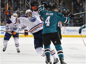 Brenden Dillon of the San Jose Sharks collides with Leon Draisaitl #29 of the Edmonton Oilers during the third period in Game Three of the Western Conference First Round during the 2017 NHL Stanley Cup Playoffs at SAP Center on April 16, 2017 in San Jose, California. The Oilers won the game 1-0.