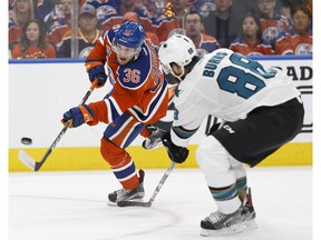 Edmonton's Drake Caggiula (36) shoots past San Jose's Brent Burns (88) during a Stanley Cup playoffs game between the Edmonton Oilers and the San Jose Sharks at Rogers Place in Edmonton on April 12, 2017.