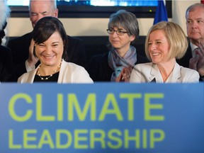 Premier Rachel Notley, right, and Environment and Parks Minister Shannon Phillips after unveiling Alberta's climate strategy in Edmonton, Alberta, on Sunday, November 22, 2015.