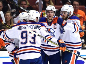 Connor McDavid #97 of the Edmonton Oilers celebrates his power play goal with Mark Letestu #55, Ryan Nugent-Hopkins #93 and Leon Draisaitl #29 to take a 2-0 lead over the Anaheim Ducks during the second period in Game 5 of their Stanley Cup playoff series.