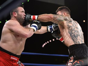 Adam Braidwood,  right, fights Tim Hague during the KO 79 boxing event at the Shaw Centre in Edmonton on Friday, June 16, 2017. He died two days later.